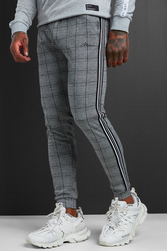 Mens Black MAN Signature Jacquard Cuff Joggers With Tape