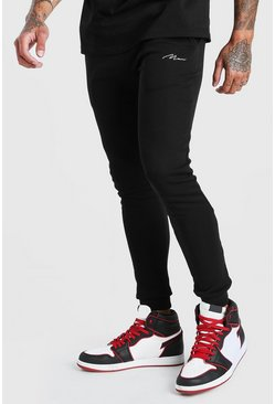 Black MAN Signature Super Skinny Joggers