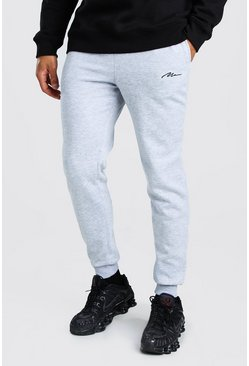 Slim Fit Jogginghosen mit MAN-Stickerei, Grau meliert