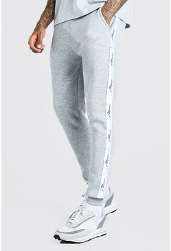 Grey Skinny Fit Jogger With MAN Signature Tape