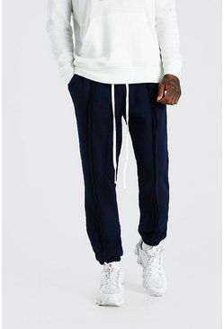 Navy MAN Official Loose Fit Raw Seam Joggers