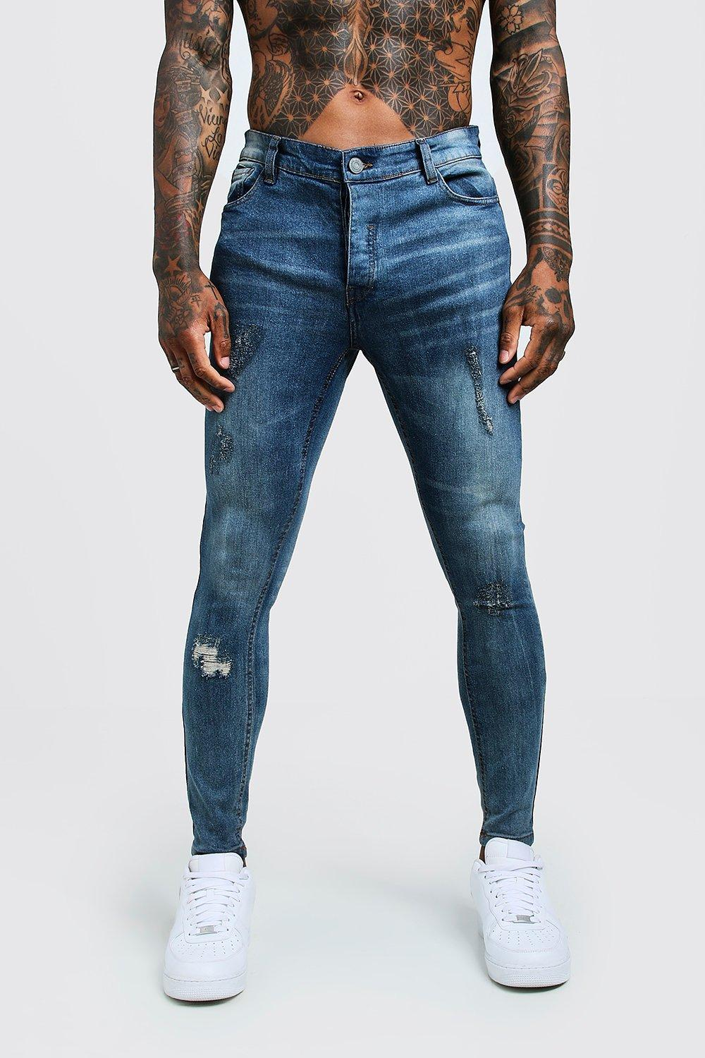 254e89b0334 ... Skinny Jeans With Ripped Knees. Hover to zoom