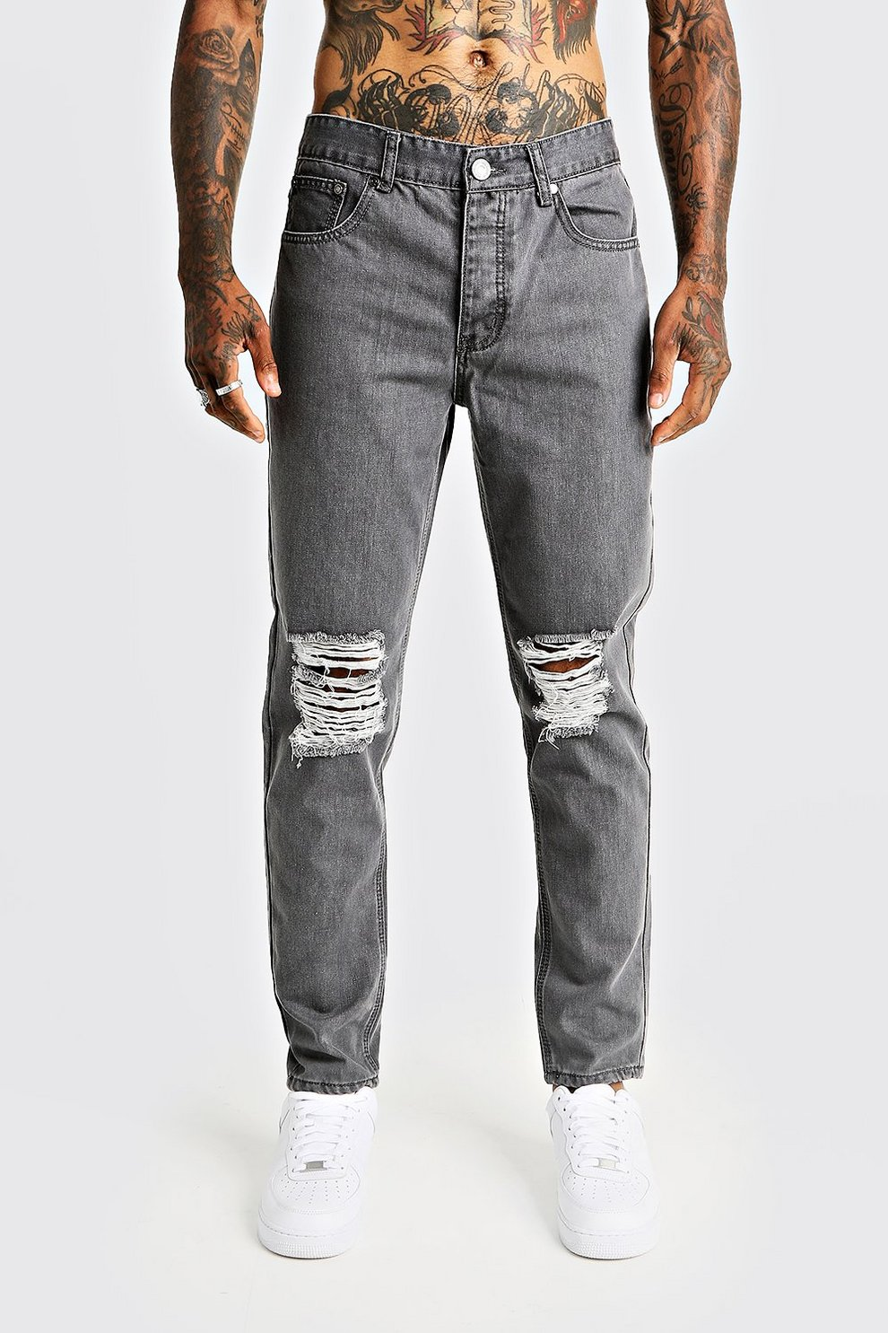 d104e7e2a1cd1 Tapered Fit Denim Jeans With Ripped Knee - boohooMAN