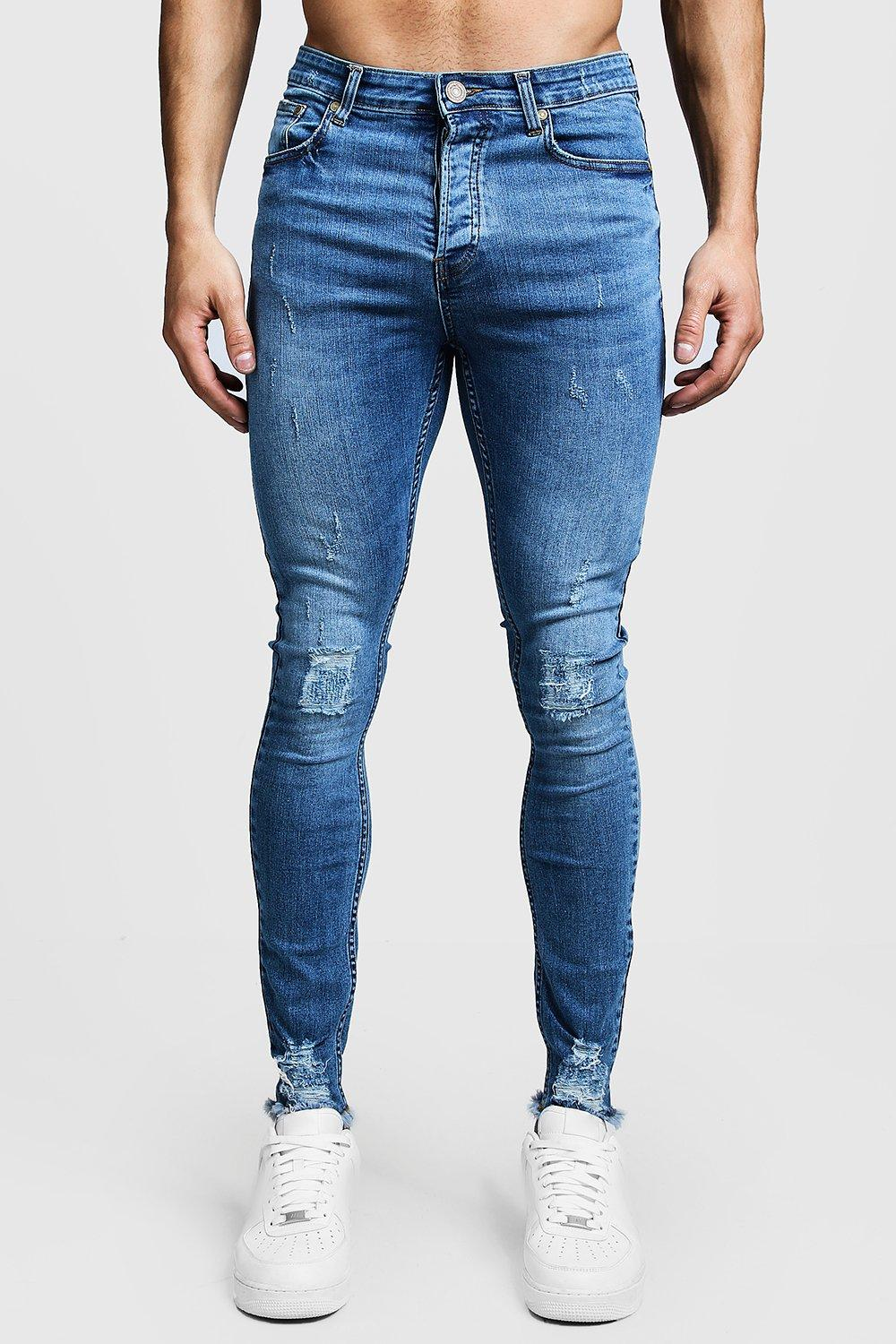 83dde1e7f0 Super Skinny Ripped Knee Jeans With Raw Hem. Hover to zoom