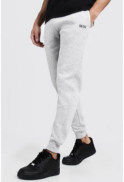 Joggings skinny brodé trait MAN, Gris