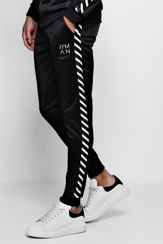 04f5b60717b6 Tricot Skinny Fit Side Tape Joggers With MAN Logo - boohooMAN