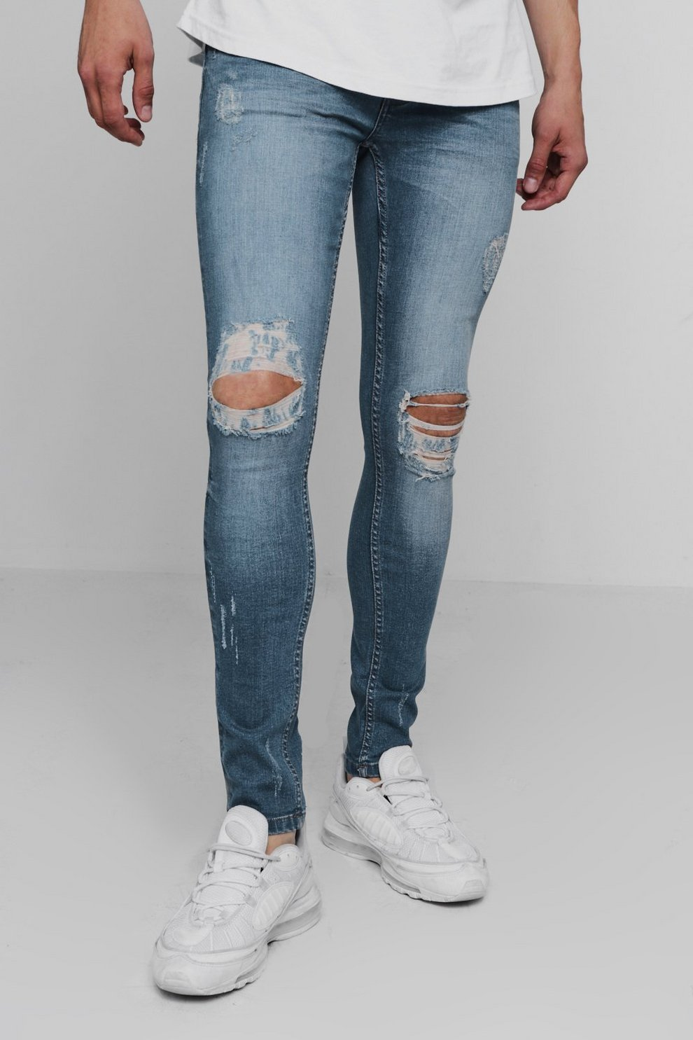 11d9069cd1 Super Skinny Ripped Knee Denim Jeans. Hover to zoom