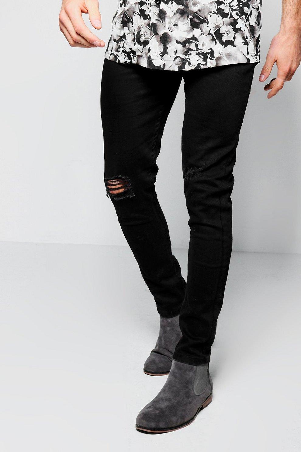 9bd96ef70409b jean skinny effet spray noir déchiré aux genoux - boohooMAN